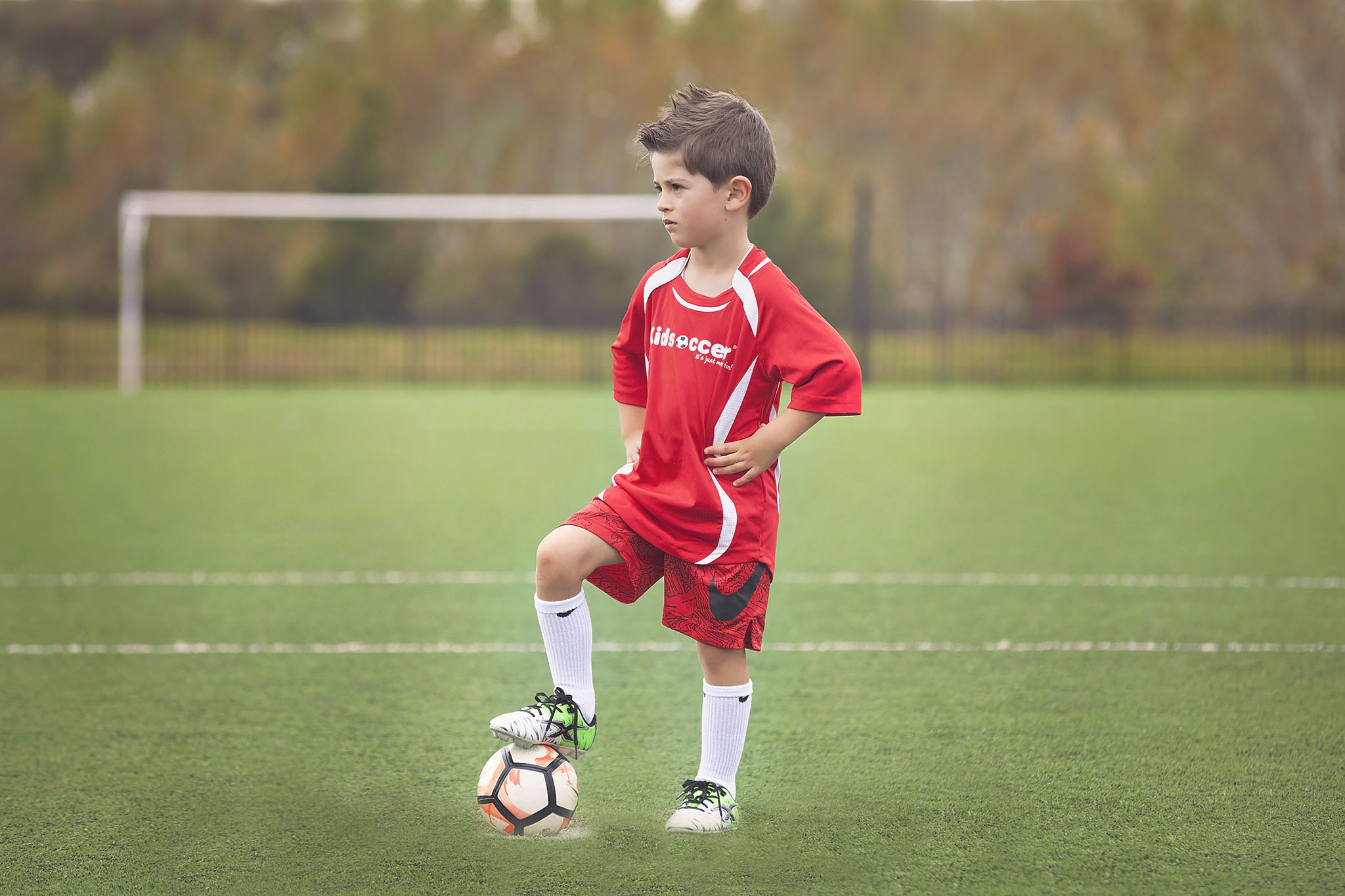 Child on the soccer pitch sports photography